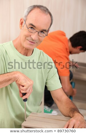 Senior man mounting cupboard Stock photo © photography33