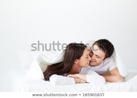 Amorous couple kissing in bed stock photo © wavebreak_media