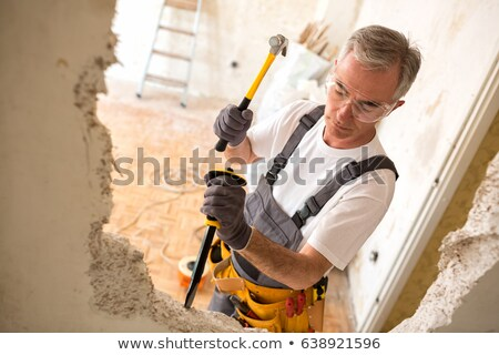 builder using a hammer stock photo © photography33