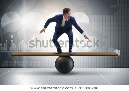 Business man Walking A Tightrope Stock photo © Lightsource