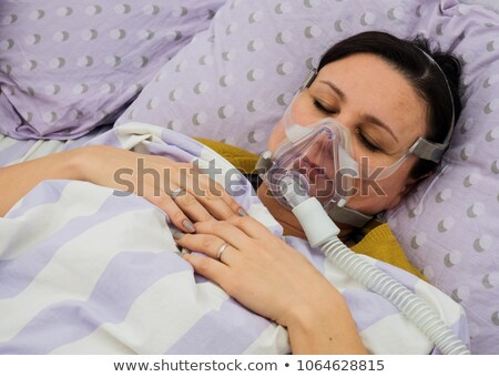 Sleeping patient with a mask on her face in a surgical room Stock photo © wavebreak_media