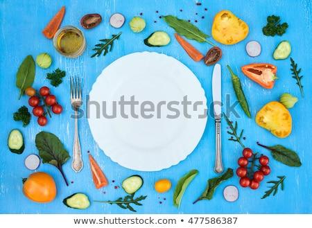 Cherry tomato and fork on plate Stock photo © stevanovicigor