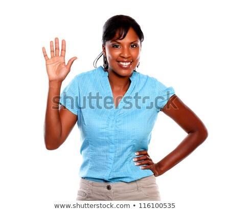 Charismatische jonge vrouw glimlachend Blauw blouse geïsoleerd Stockfoto © pablocalvog