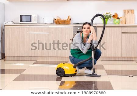 Tired woman with vacuum cleaner Stock photo © wavebreak_media