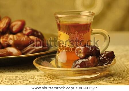 çay fincanı tatlı kurutulmuş tarih meyve yeşil Stok fotoğraf © M-studio