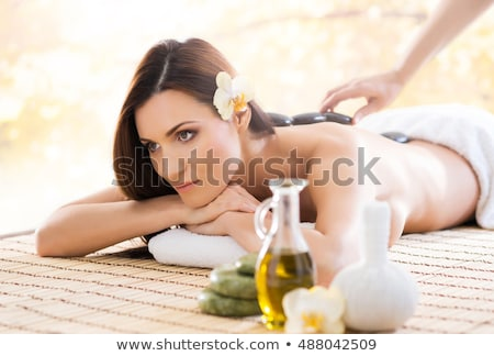 woman laying on bamboo mat Stock photo © chesterf