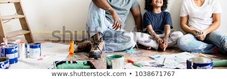 Family painting wall of new home Stock photo © Kzenon
