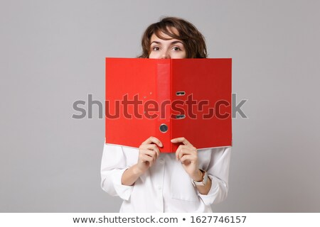funny businesswoman with red folder on white stock photo © elnur