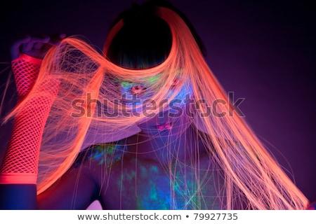 Glowing Woman Wearing UV Cosmetics Under Black Light Stock photo © tobkatrina