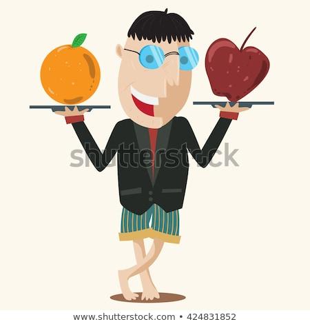 Caucasian man comparing apple to orange stock photo © dgilder