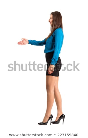 Side profile of a young woman offering hand for handshake Stock photo © bmonteny
