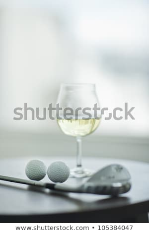 Glass of wine and golf ball  Stock photo © CaptureLight