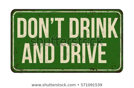Alcohol on Warning Road Sign. Stock photo © tashatuvango
