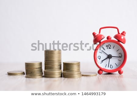 golden coin stack and vintage clock stock photo © stevanovicigor