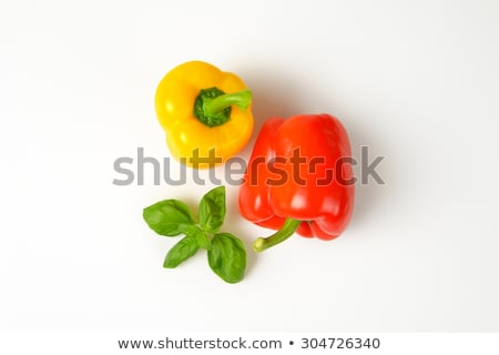 red and yellow pepper and green leaf Stock photo © konturvid