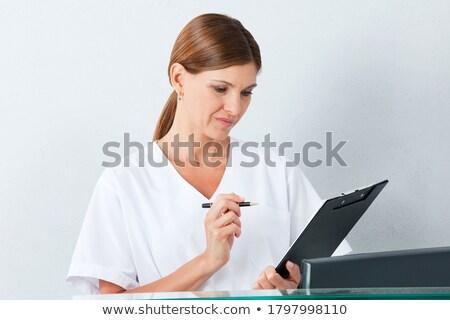 Dentaires assistant lecture fichier clinique infirmière Photo stock © wavebreak_media