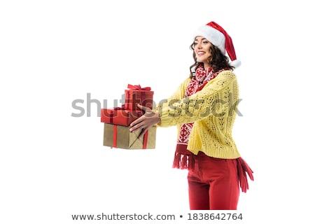 Smiling brunette in red jumper hat holding a gift Stock photo © wavebreak_media