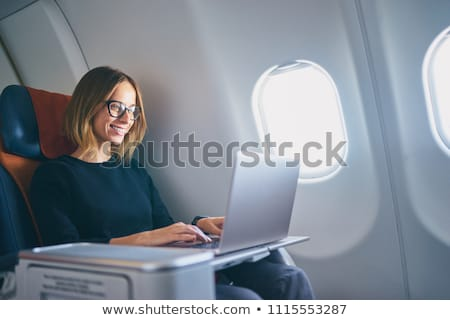 businesswoman flying with a laptop stock photo © imagedb