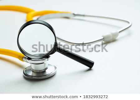 Closeup of hand using stethoscope on wrist stock photo © nyul
