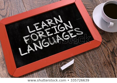 Learn Foreign Languages. Inspirational Quote on Chalkboard. Stock photo © tashatuvango