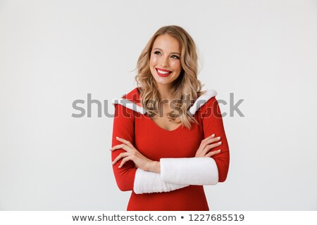 Happy woman in santa claus cloth standing with arms folded Stock photo © deandrobot