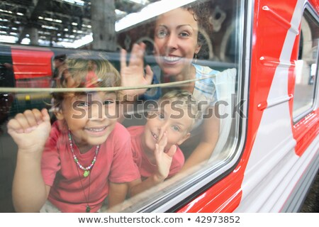 mother and son look in train`s window stock photo © Paha_L
