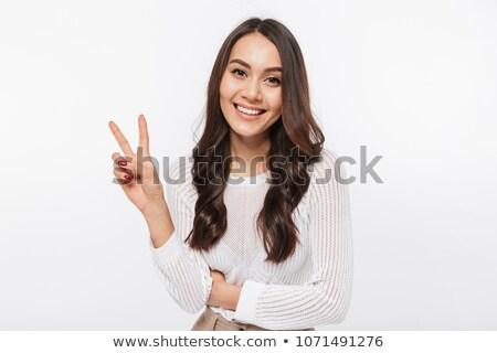 Kız zafer jest genç kadın imzalamak Stok fotoğraf © Aikon