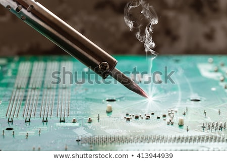 smoking soldering iron  stock photo © OleksandrO