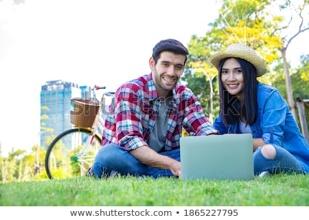 Couple on bicycle resting and flirting Stock photo © deandrobot