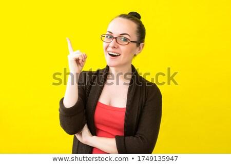 genç · kadın · gülen · işaret · yukarı · yalıtılmış - stok fotoğraf © deandrobot