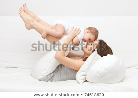 Image of mother and baby on sofa Stock photo © deandrobot
