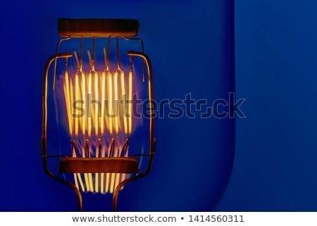 Incandescent lamps in a modern studio on blue background. Edison Stock photo © Yatsenko