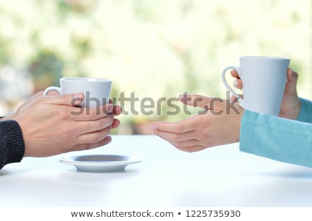 Dialogue of two women sitting in cafe Stock photo © deandrobot