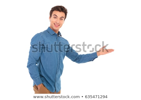 amazed young casual man presenting  Stock photo © feedough