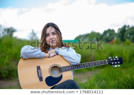 Portre güzel kız park güneş gözlüğü çim şehir Stok fotoğraf © tekso