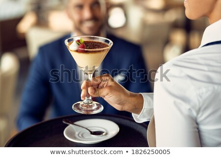 Waitress serving sweet food to customers Stock photo © wavebreak_media