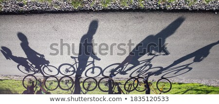 Shadow of unrecognizable cyclist on the road Stock photo © stevanovicigor