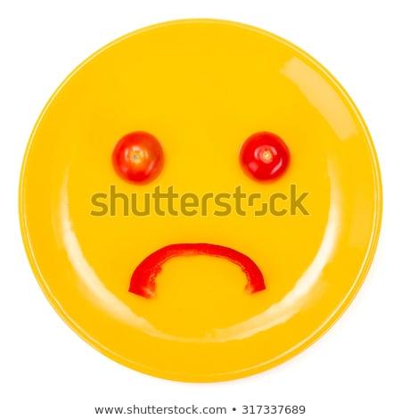 Triste cara sonriente placa amarillo tomate pimienta Foto stock © erierika