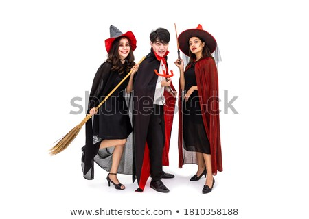 Smiling woman in halloween costume holding broom Stock photo © deandrobot
