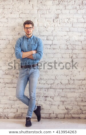 Full lenght image of serious young man Stock photo © deandrobot