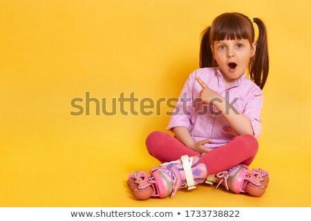 Young girl on floor,  mothers legs aside Stock photo © IS2