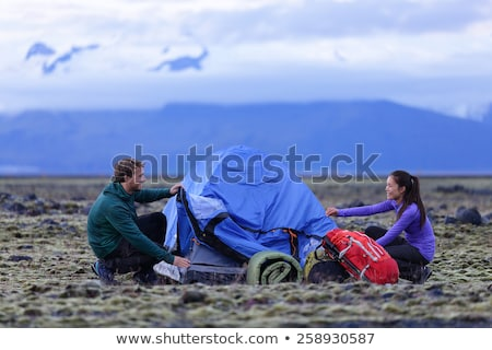 two girls putting up tent stock photo © is2
