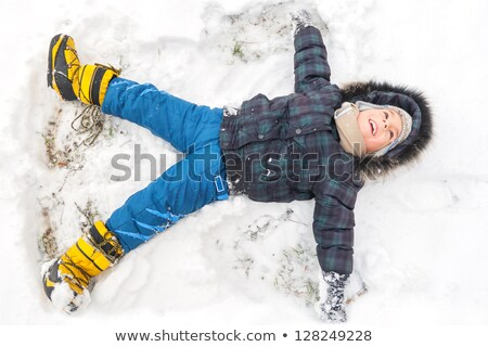 Child on skis lying in the snow. Stock photo © IS2