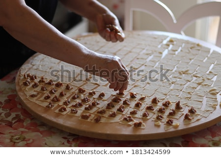 cook puts minced meat on dough Stock photo © ssuaphoto