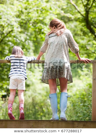 Mother and daughter looking over railing Stock photo © IS2