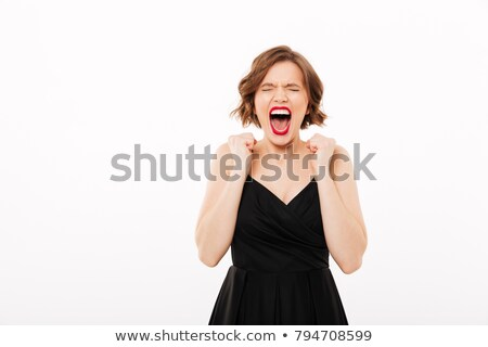 Portrait of a furious girl dressed in black dress screaming Stock photo © deandrobot