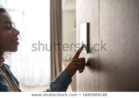 woman adjusting climate control stock photo © is2