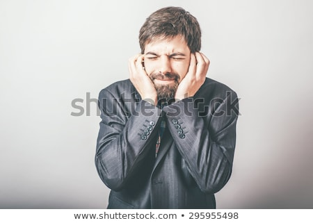 Asian boy covered his ears Stock photo © szefei