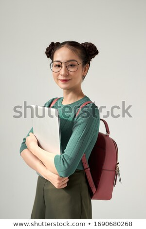Woman holding notebook to chest Stock photo © IS2