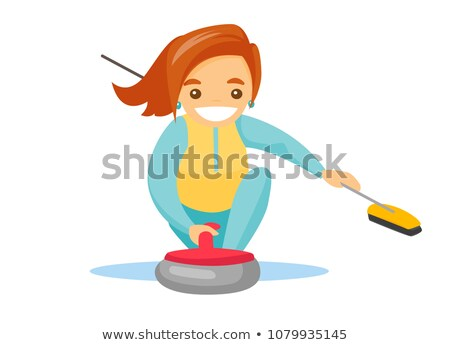 Caucasian sportswoman playing curling on ice rink. Stock photo © RAStudio